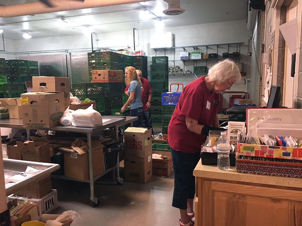 volunteers sorting through food at the food bank