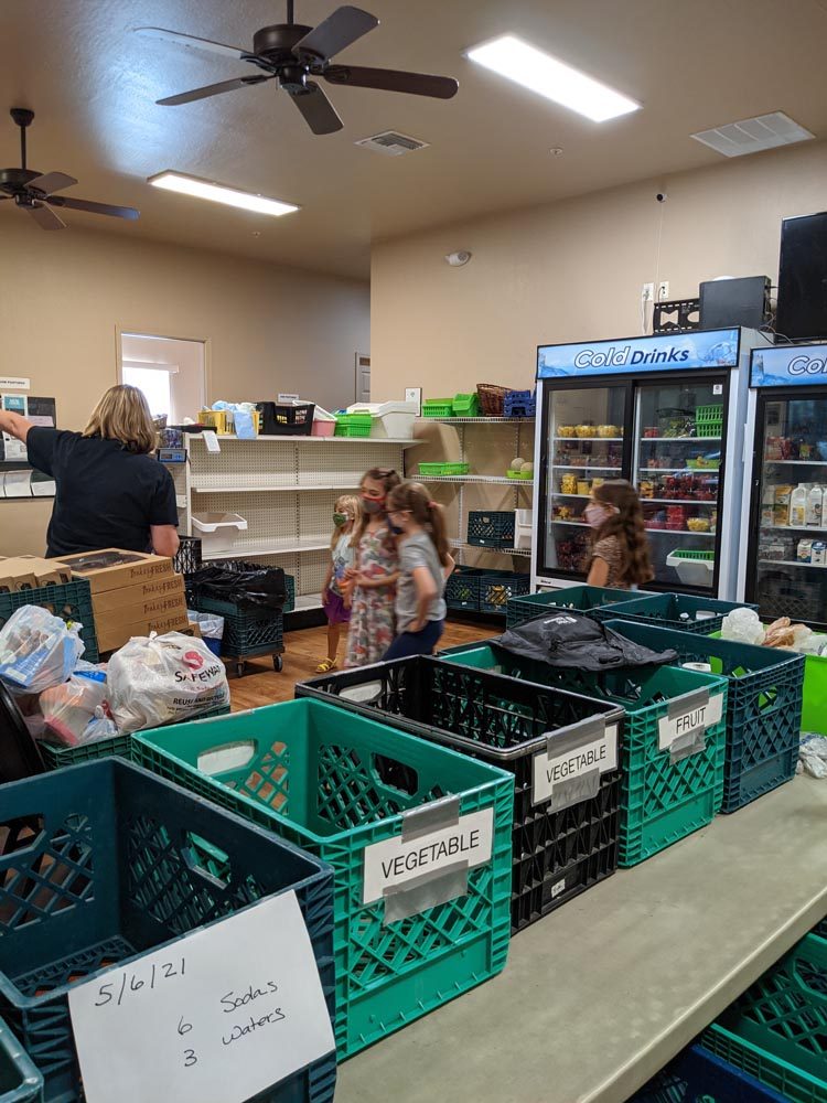 girl scouts visit the foothills food bank